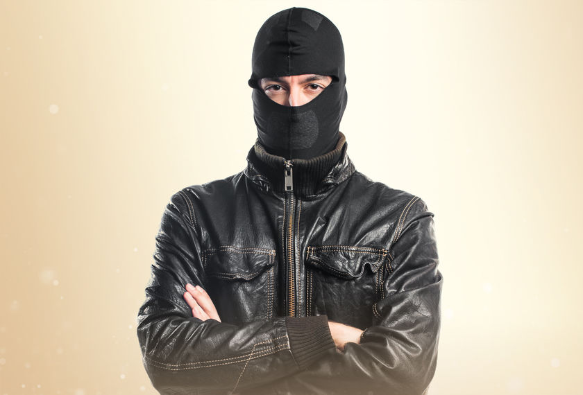 robber with his arms crossed
